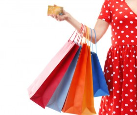 Holding a shopping bag with a bank card for a woman Stock Photo 07