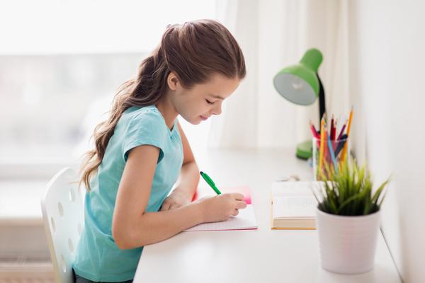 Homework little girl Stock Photo