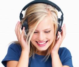 Listen to music girls Stock Photo