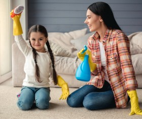Mom and daughter cleaning house Stock Photo 01