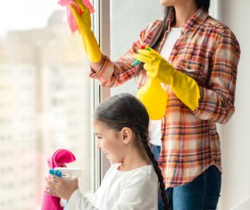 Mom and daughter cleaning house Stock Photo 02
