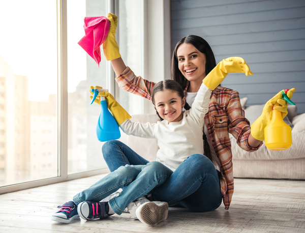 Mom and daughter cleaning house Stock Photo 03