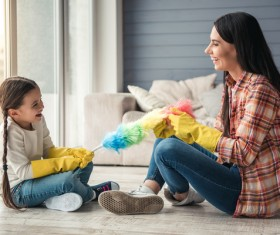 Mom and daughter cleaning house Stock Photo 04