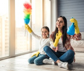 Mom and daughter cleaning house Stock Photo 05