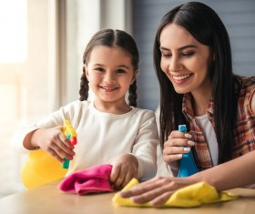 Mom and daughter cleaning house Stock Photo 07