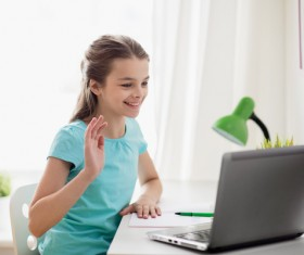 Online video call to the little girl Stock Photo