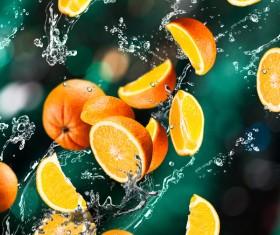 Oranges and splashing water Stock Photo 01