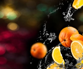Oranges and splashing water Stock Photo 02