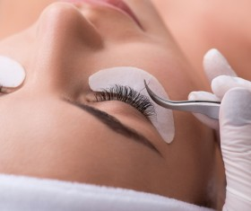 Pretty girl having her lashes lengthened Stock Photo 01