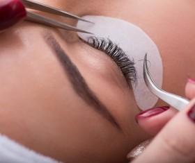 Pretty girl having her lashes lengthened Stock Photo 03