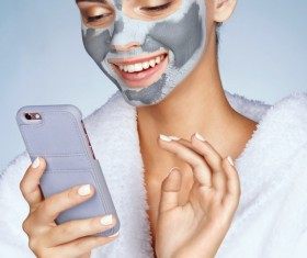 Skin care and play smart phone girl HD picture 01