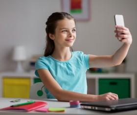Smart phone self-timer little girl Stock Photo