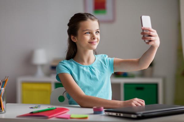 Smart phone self timer little girl Stock Photo