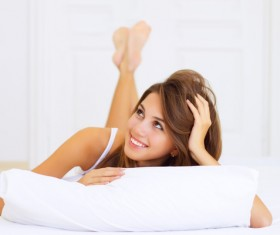 Smiling girl lying on the bed Stock Photo 03