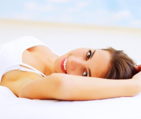 Smiling girl lying on the bed Stock Photo 05