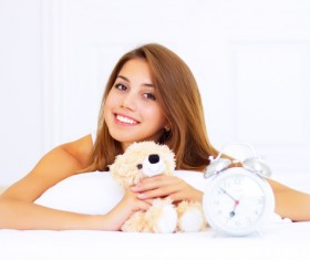 Smiling girl lying on the bed Stock Photo 06