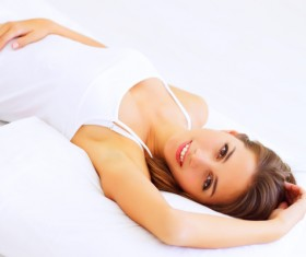 Smiling girl lying on the bed Stock Photo 07