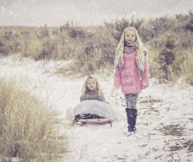 The sisters in the snow Stock Photo