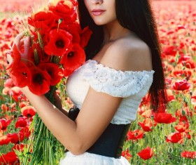 Women who hold poppy flowers HD picture