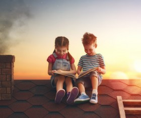 child reading on the roof Stock Photo