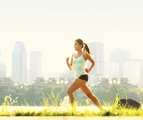 A woman with a ponytail running Stock Photo