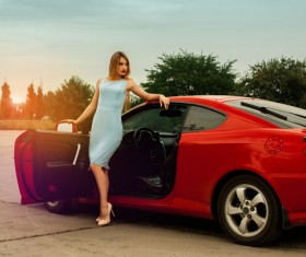 Beautiful girl with red sports car Stock Photo