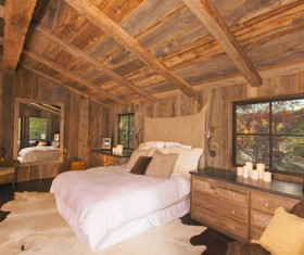 Bedroom with double bed in the hut Stock Photo