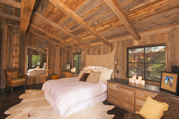 Luxurious Rustic Log Cabin Bedroom In A Rural Setting