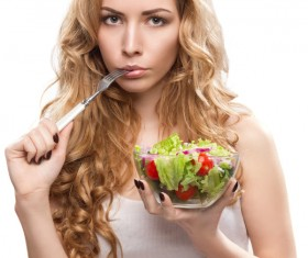 Bite the fork and the woman holding the salad HD picture