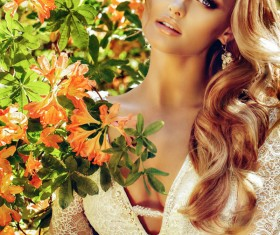 Blonde beautiful woman with flowers 02
