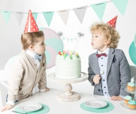 Blowing birthday candles for kids Stock Photo