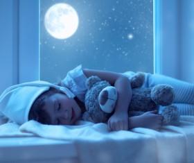 Bright moon shone on the sleeping girl Stock Photo