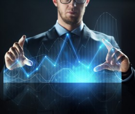 Businessman with virtual charts Stock Photo 01