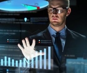 Businessman with virtual charts Stock Photo 07