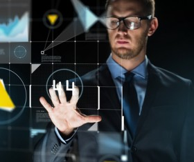 Businessman with virtual charts Stock Photo 08
