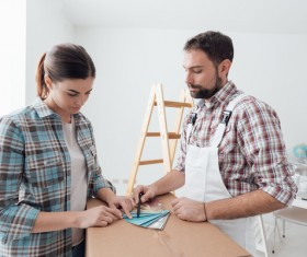 Couples choose wall colors Stock Photo