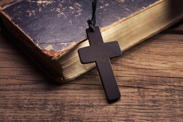 closeup of wooden christian cross on bible free download