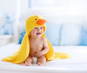 Dressed in small yellow duck coat baby HD picture