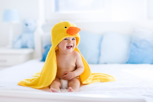 baby after bath in yellow duck towel