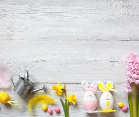 Easter wooden background with eggs, candy and flowers Stock Photo 01