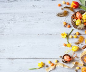 Easter wooden background with eggs, candy and flowers Stock Photo 02