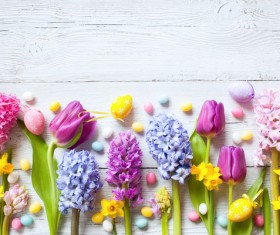 Easter wooden background with eggs, candy and flowers Stock Photo 04
