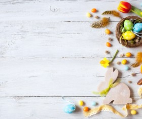 Easter wooden background with eggs, candy and flowers Stock Photo 05