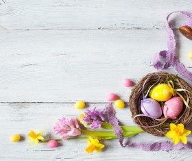 Easter wooden background with eggs, candy and flowers Stock Photo 08