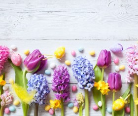 Easter wooden background with eggs, candy and flowers Stock Photo 09