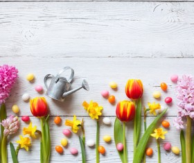 Easter wooden background with eggs, candy and flowers Stock Photo 10