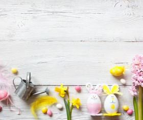 Easter wooden background with eggs, candy and flowers Stock Photo 11
