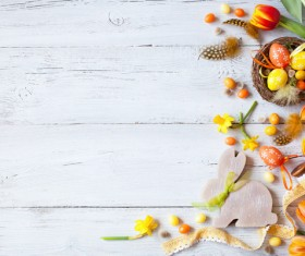 Easter wooden background with eggs, candy and flowers Stock Photo 12