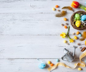 Easter wooden background with eggs, candy and flowers Stock Photo 15
