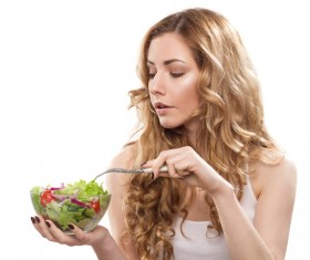 Eat vegetable salad with a fork woman HD picture